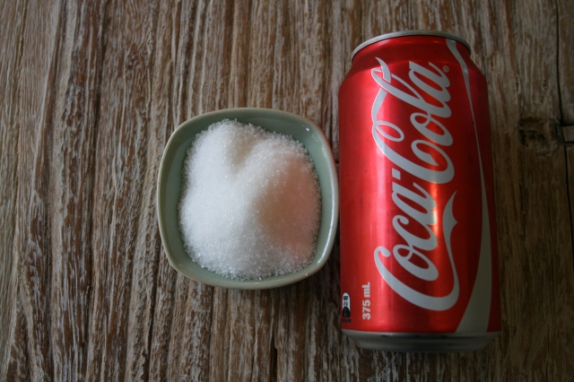 Water would be a better choice, since a 375ml can of coke has 40g of sugar.