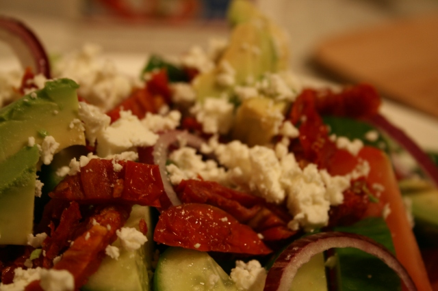 Break up a decent amount of feta cheese and spread over the top of your salad